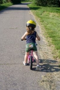 1179434-little-girl-riding-on-her-pink-bike